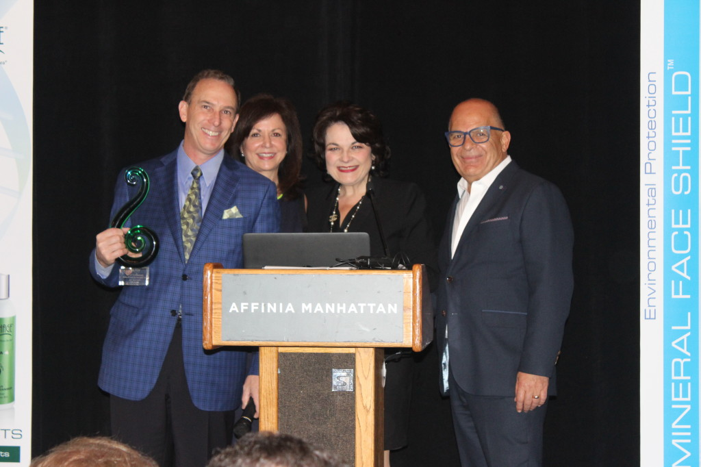 (Dr. Samuel and Joni Shatkin accepting the Trendsetter of the Year award from Lydia and David Sarfati)