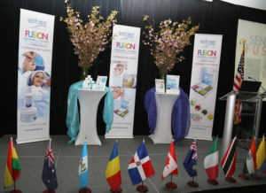 Internaional flags on the stage to represent attendees from around the globe at the Repechage 18th Annual International Conference