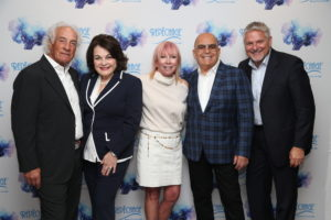 Lydia and David Sarfati with Mario (left) and Cheryl Tricoci (center), Owners of Tricoci University, and Paul Dykstra, CEO of America's Beauty Show